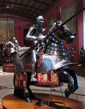 knight in plate armour on  horse