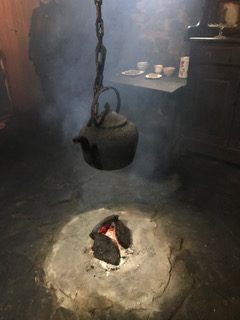 A central fire used for heat and cooking